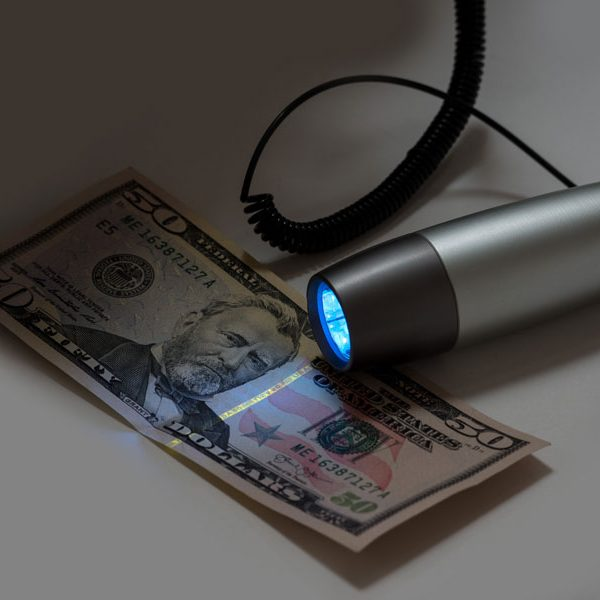 UV Pro with coil shining on fifty dollar bill glam photo
